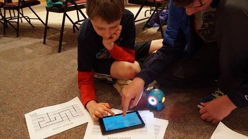 Child playing with iPad and solving a puzzle.