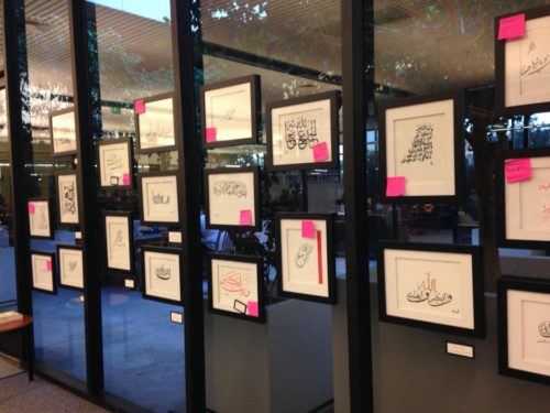 Hanging the Islamic Calligraphy Show on the atrium windows in 2014
